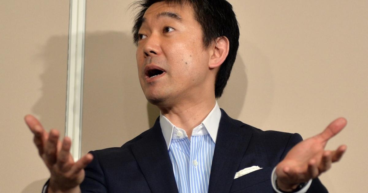 Osaka mayor and co-leader of the Japan Restoration Party Toru Hashimoto speaks before press at the Osaka city hall in Osaka, western Japan on May 24, 2013.</p>