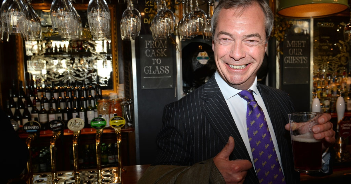UK Independent Party (UKIP) leader Nigel Farage enjoys a pint of beer in a pub in central London on May 3, 2013. The anti-immigration UK Independence Party (UKIP) was celebrating some of its best ever results following local elections which delivered a bloody nose to Britain's ruling coalition.</p>