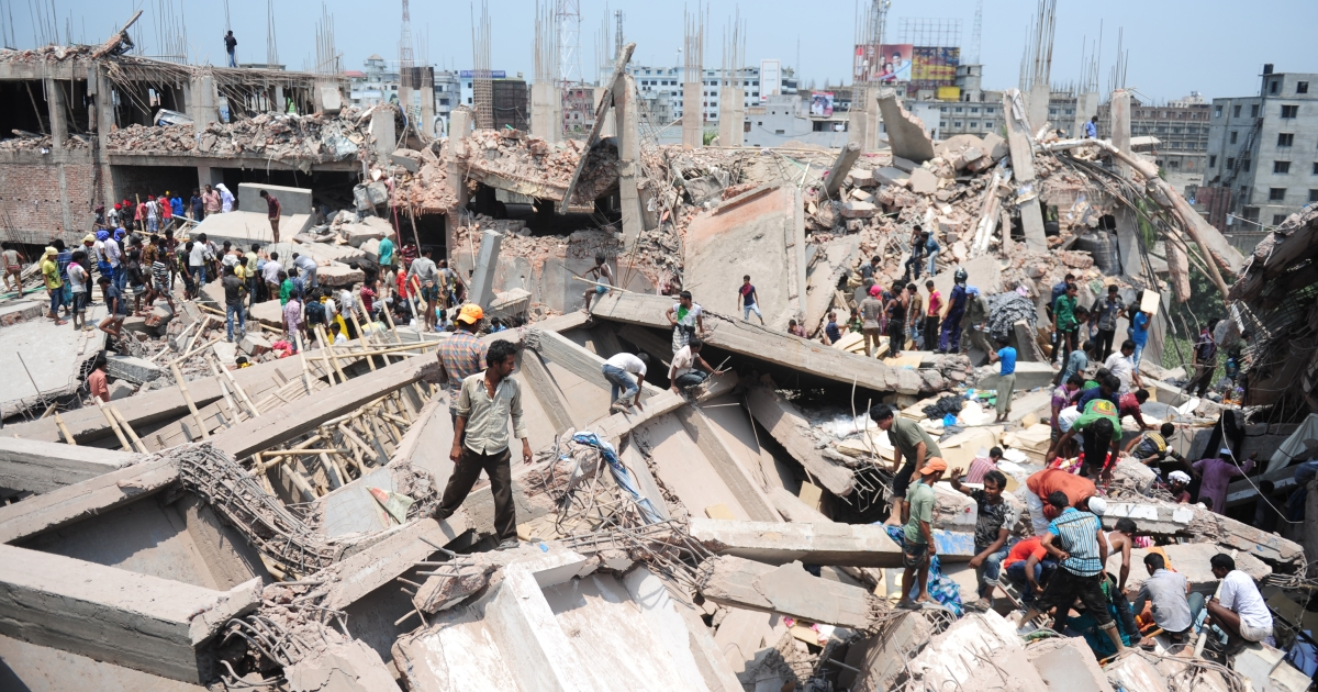 Rescue and recovery workers continue their search through the nine-story building's tangled wreckage in Savar, a suburb of the capital, Dhaka.</p>