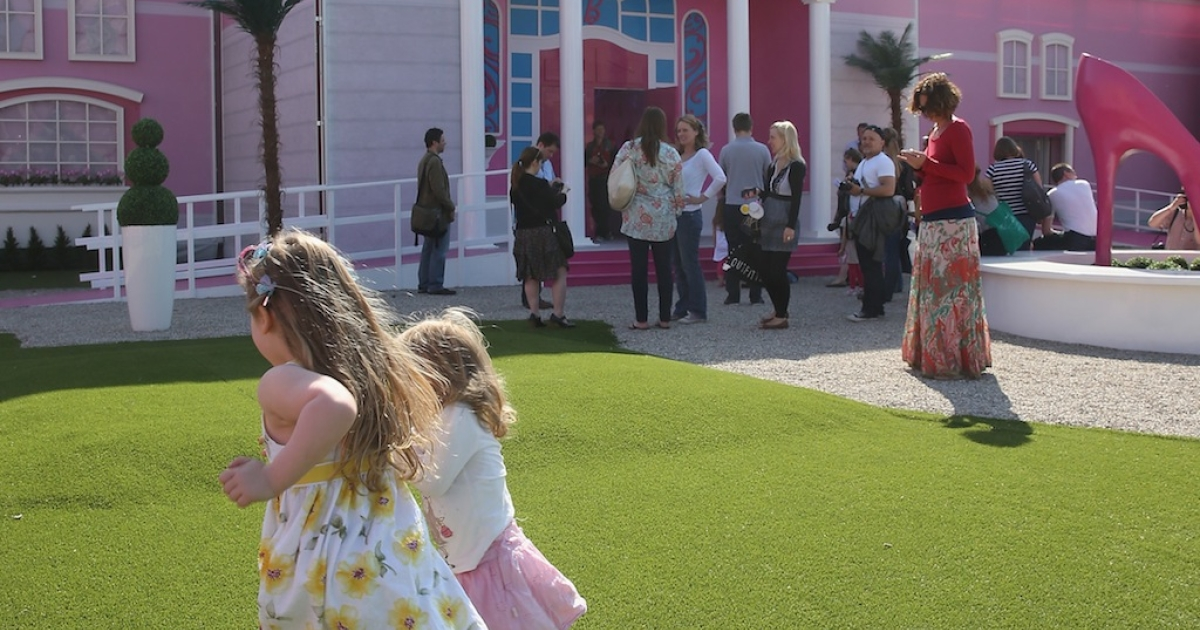 Visitors wait to enter the Barbie Dreamhouse Experience on May 16, 2013 in Berlin, Germany. The Barbie Dreamhouse is a life-sized house full of Barbie fashion, furniture and accessories and will be open to the public until August 25 before it moves on to other cities in Europe.</p>
