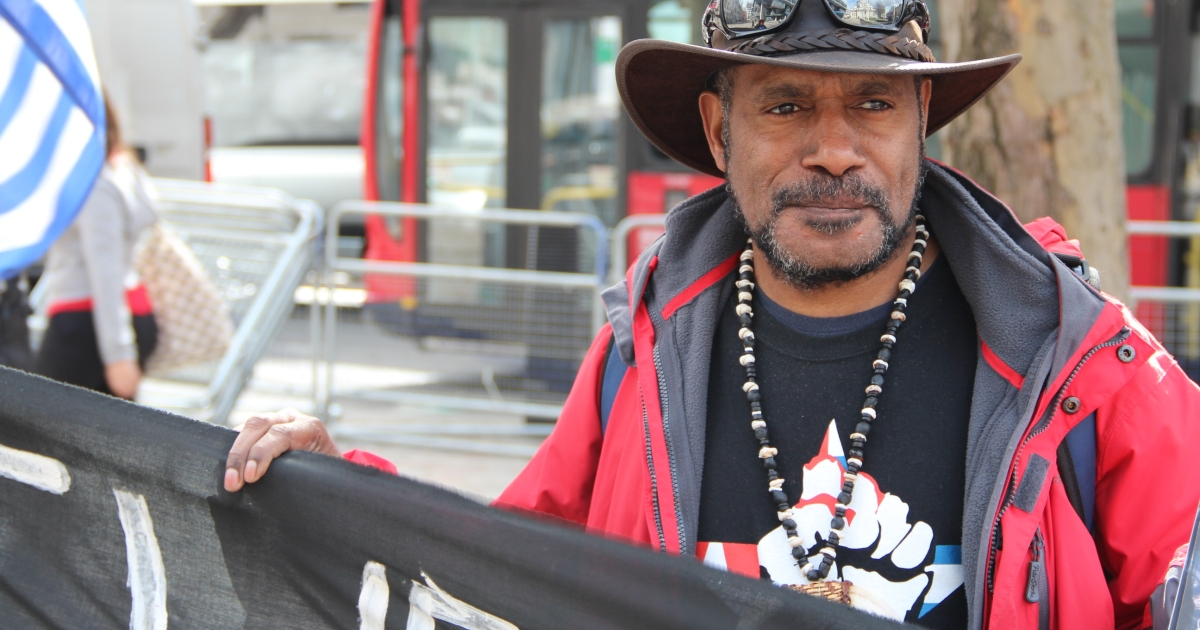 Benny Wenda, who was exiled from West Papua, protesting the Grasberg mine —partially owned by Rio Tinto —in his home country in April 2013.</p>