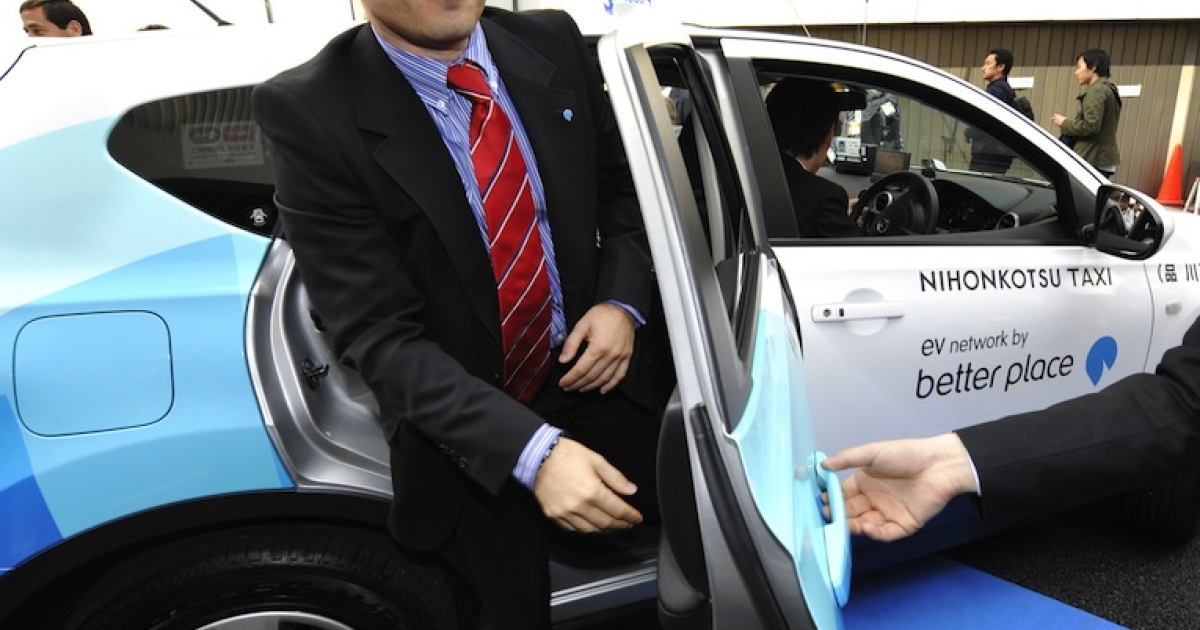 Shai Agassi, founder and chief executive officer of electric vehicle services provider, Better Place, gets out of the world's first switchable-battery electric taxi in Tokyo on April 26, 2010. Better Place announced on Sunday that it had filed a motion in an Israeli court to wind up the company.</p>