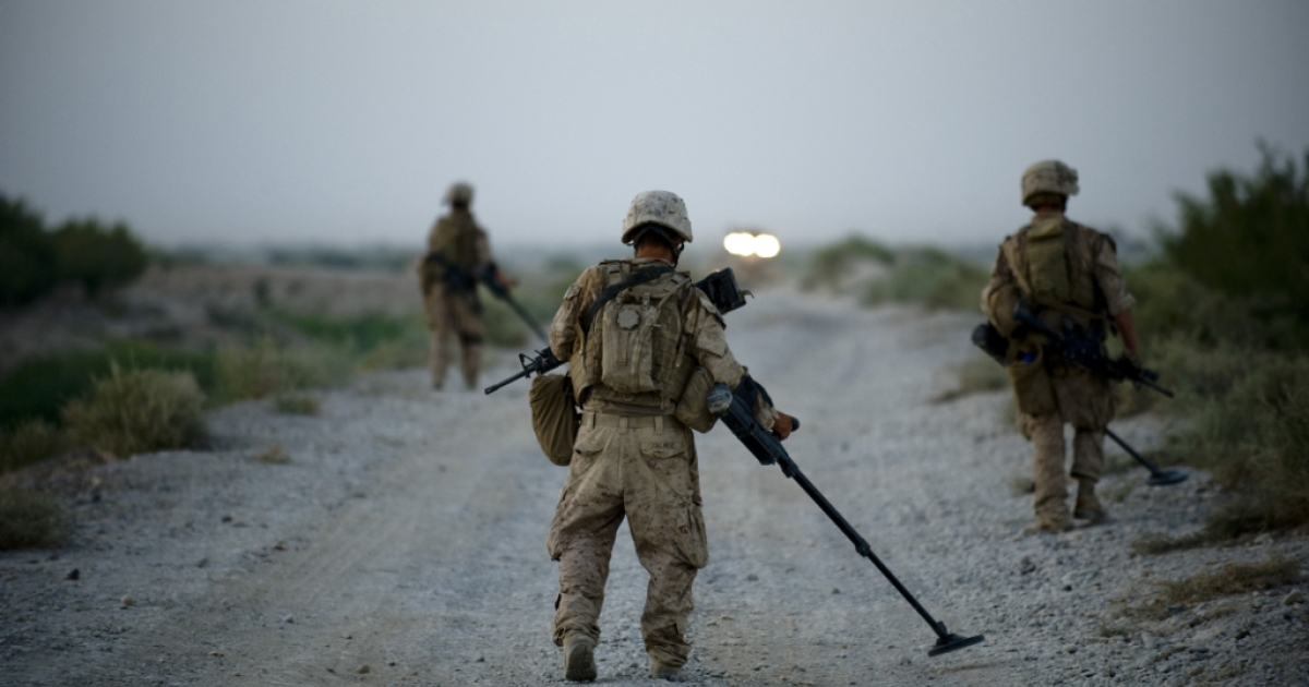 US Marines of 1st Combat Engineering Battalion of 2nd Marine Expeditionary Brigade sweep the road for Improvised Explosive Devices in Garmsir district of Helmand Province on July 13, 2009.</p>