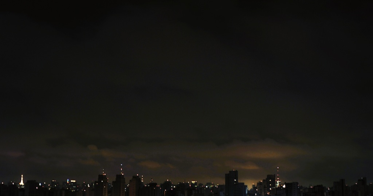 The dark Sao Paulo skyline is etched in light by antennas atop buildings. Brazil's supercharged growth has led analysts to caution for possible signs of trouble looming.</p>