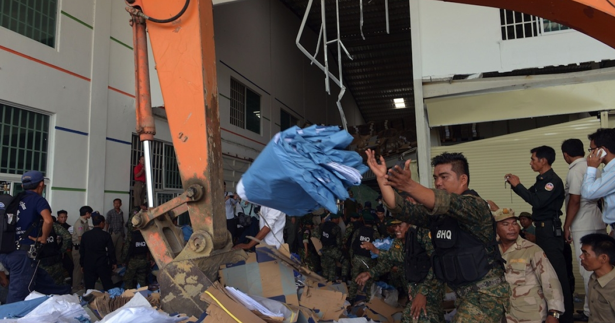 Cambodian soldiers move debris after a factory collapsed in Kampong Speu province, some 50 kilometers west of Phnom Penh on May 16, 2013. A ceiling collapsed at a shoe factory in Cambodia on May 16 killing at least two workers, police said, stoking concerns about industrial safety after last month's disaster in Bangladesh.</p>