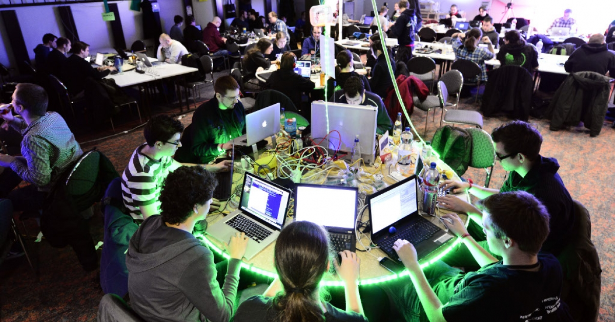 Participants work at their laptops at the annual Chaos Computer Club (CCC) computer hackers' congress, called 29C3, on December 28, 2012 in Hamburg, Germany. The 29th Chaos Communication Congress (29C3) attracts hundreds of participants worldwide annually to engage in workshops and lectures discussing the role of technology in society and its future.</p>