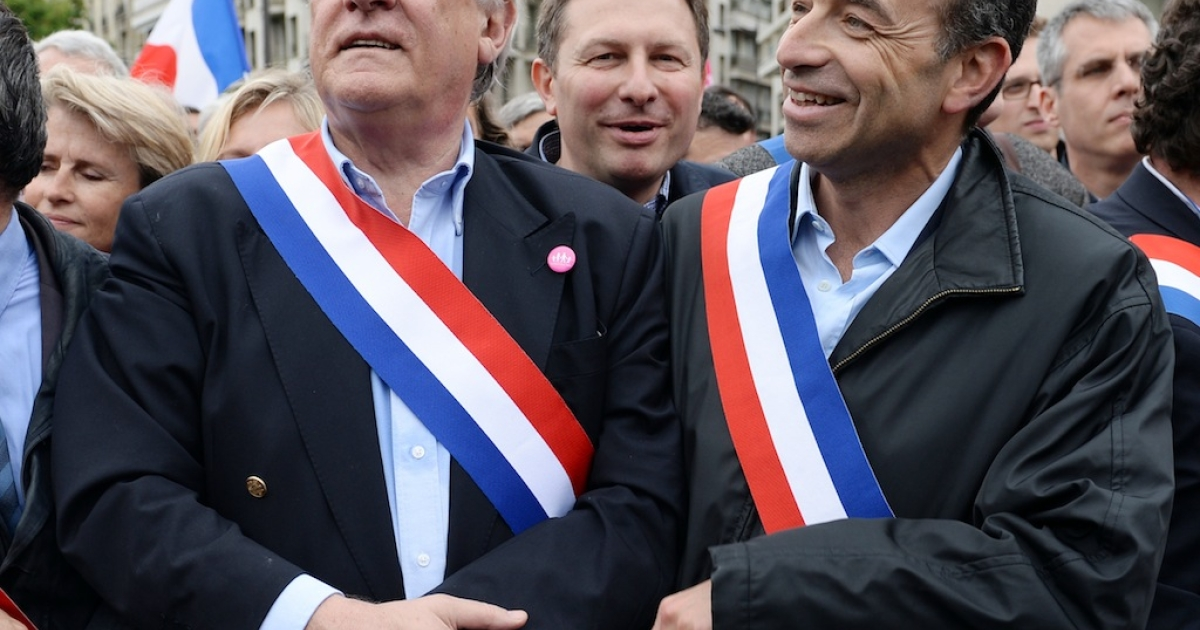 French UMP opposition right-wing party president Jean-Francois Cope (R) and MP Claude Goasguen (L) head a delegation of UMP officials in a mass protest on May 26, 2013, in Paris against a gay marriage law.</p>