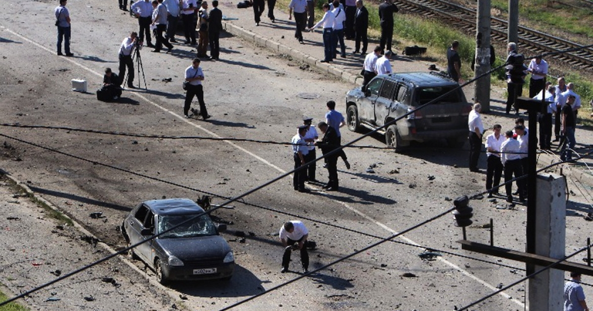 Police work at a blast site outside a building used by court bailiffs in central Makhachkala on May 20, 2013.</p>