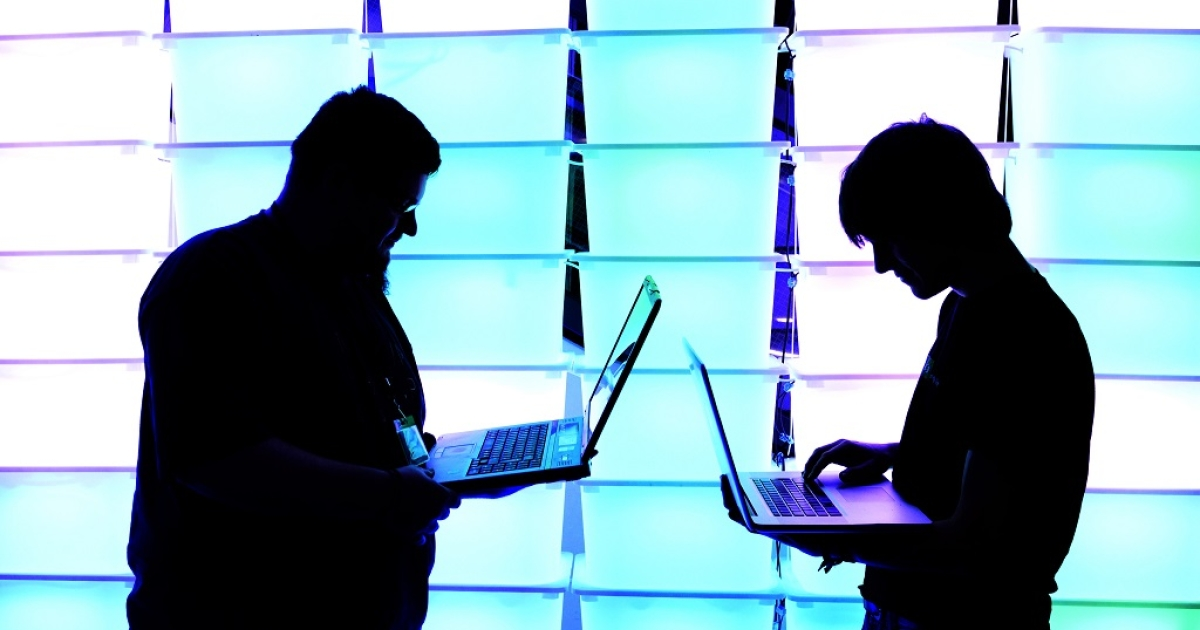 Participant hold their laptops in front of an illuminated wall at the annual Chaos Computer Club (CCC) computer hackers' congress, called 29C3, on December 28, 2012 in Hamburg, Germany. The 29th Chaos Communication Congress (29C3) attracts hundreds of participants worldwide annually to engage in workshops and lectures discussing the role of technology in society and its future.</p>