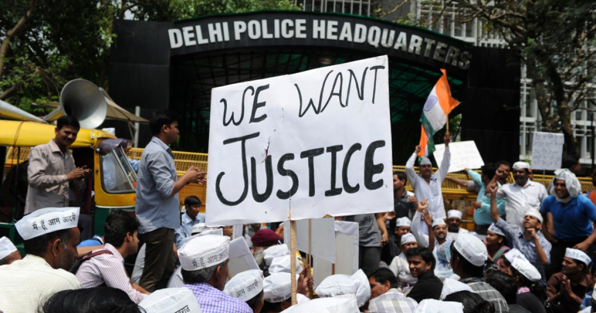 Indian protestors shout anti-government slogans during a demonstration against the rape of a five-year old girl, in front of police headquarters in New Delhi on April 21, 2013.</p>