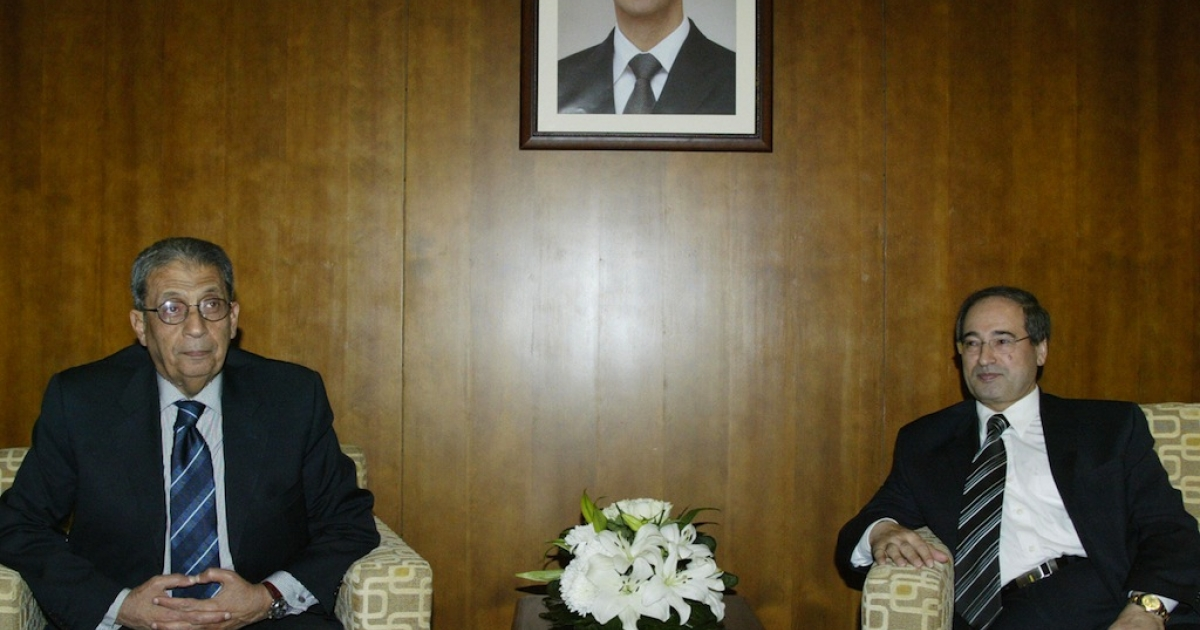 Syrian Deputy Foreign Minister Faisal Mekdad (R) receives Arab League Secretary General Amr Mussa in Damascus on March 24, 2008.</p>