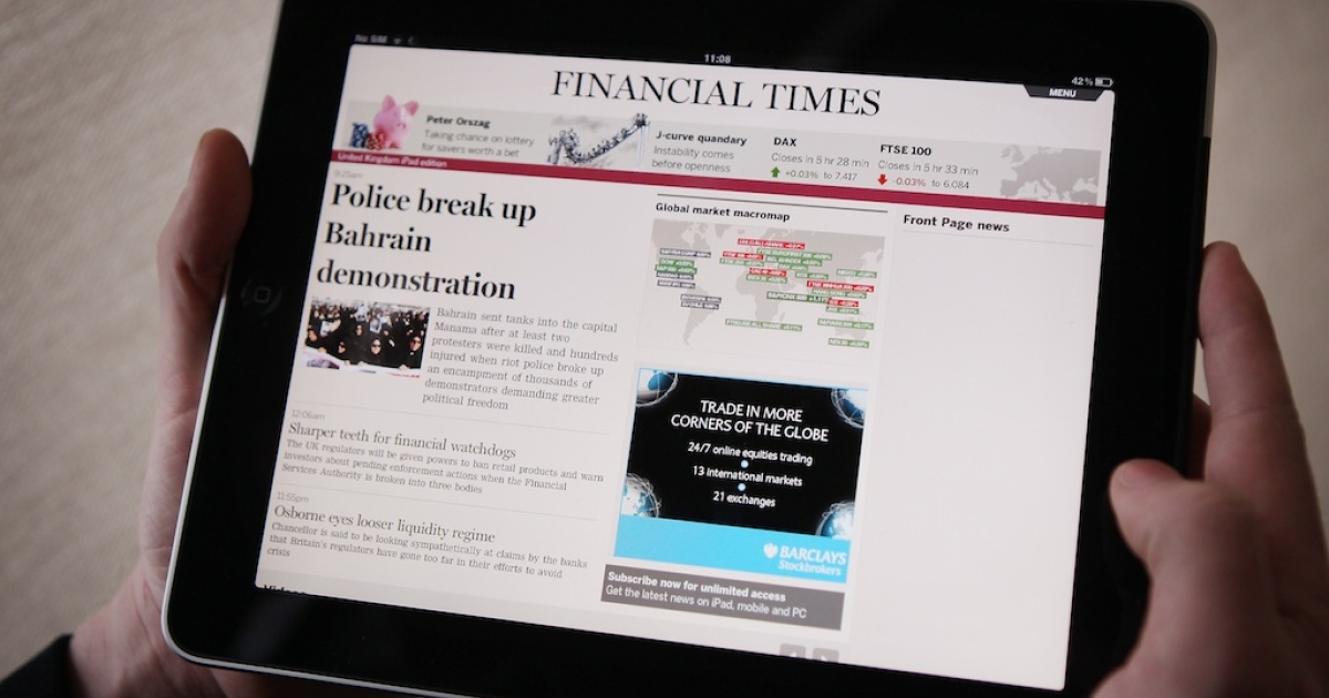 The Financial Times website and Twitter feeds were hacked on Friday. The Syrian Electronic Army claimed responsibility. In this photo illustration, a man looks at The Financial Times app on an Apple iPad tablet.</p>