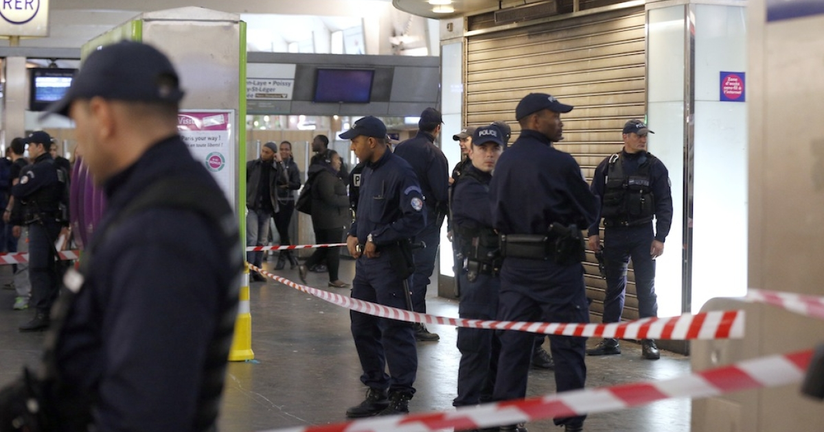 Police officers stand at the site where a man armed with a box cutter attacked a French soldier patrolling a subway station of Paris' business district, stabbing him in the neck, on May 25, 2013 in La Defense. The soldier in uniform was armed and was patrolling as part of France's Vigipirate anti-terrorist surveillance scheme.  France's defense minister said the soldier stabbed in Paris Saturday was targeted because he was in the army and vowed to continue his country's