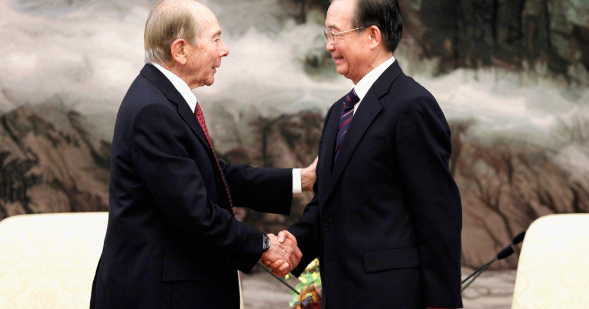 Former Chinese Premier Wen Jiabao (R) shakes hands with Maurice Greenberg (L), former chairman and CEO of American International Group (AIG) in a meeting with entrepreneurs from various countries during the China Development Forum at The Great Hall of The People in Beijing on March 19, 2012.</p>