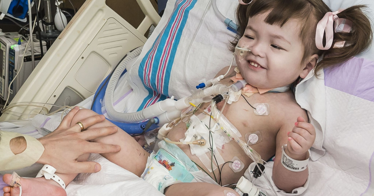Hannah Warren recovers after surgery at Children's Hospital of Illinois in Peoria. Hannah, 2 1/2, was born without a windpipe, but doctors used stem cells from her hip to create a new trachea.</p>