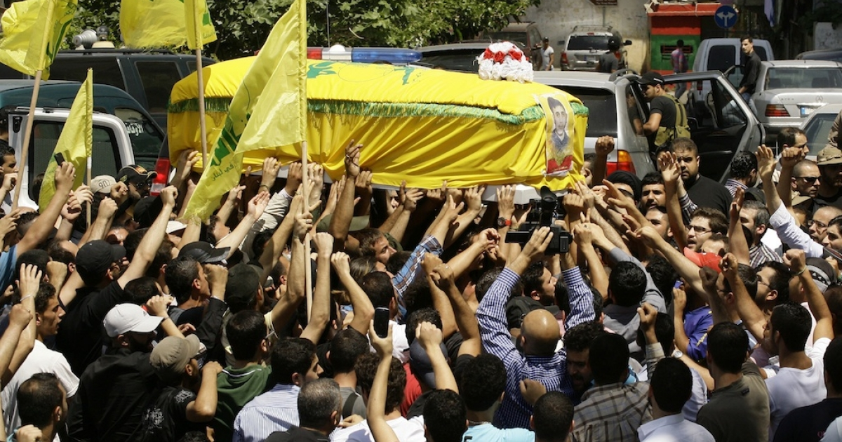 Members and supporters of Lebanon's Shiite Hezbollah movement carry the coffin of their comrade Saleh Ahmad Sabbagh during his funeral in the southern port city of Sidon on May 22, 2013. Local media said Sabbagh, the son of a Sunni father and a Shiite mother, who converted to Shiite Islam and joined Hezbollah years ago, was killed in the ongoing battle of Qusayr in the Syrian province of Homs.</p>