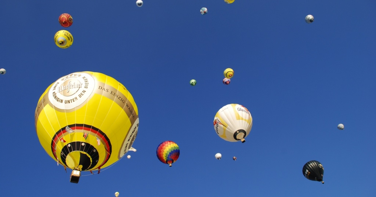 Hot air balloons mark the end of the Warstein International Montgolfiade, Europe's largest hot air balloon festival, in Germany on September 8, 2012.</p>