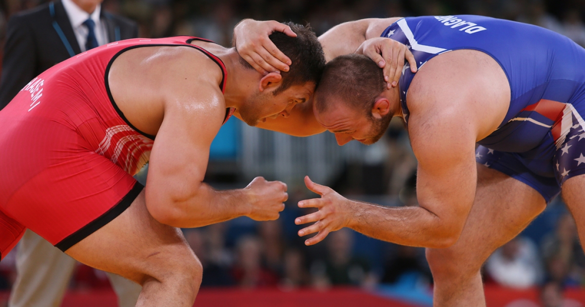 Iran's Komeil Ghasemi, left, wrestles American Tervel Ivaylov Dlagnev in their men's 120-kg freestyle wrestling bronze-medal match on August 11, 2012 at the London Olympics.</p>