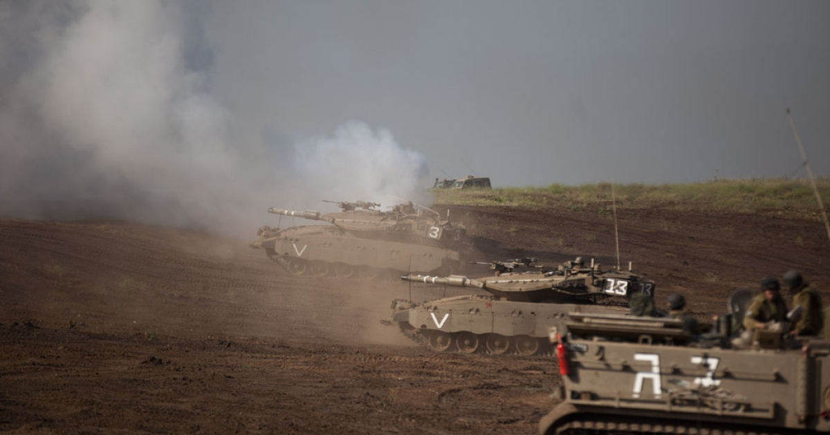 Israeli Merkava tanks participate in a drill near the border with Syria at the Israeli-annexed Golan Heights on May 6, 2013. Syria has accused Israel of launching a series of airstrikes this weekend on targets near the Lebanon/Syria border, including an arms shipment and the Jamraya research centre, that was thought to produce chemical weapons.</p>