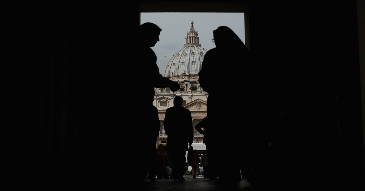 A beggar asks a nun for money near St Peter's Basilica on March 26, 2013 in Rome.</p>