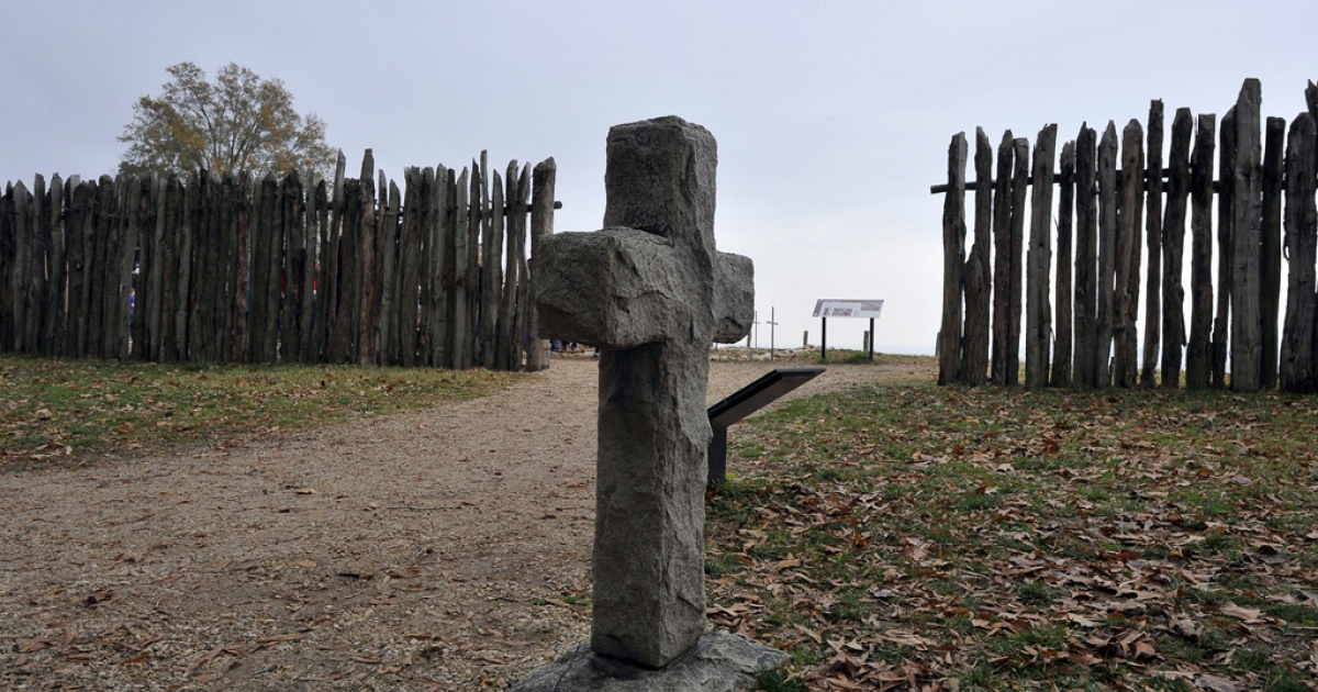 A stone cross marking the grave of a 17th century settler is seen at the archaeological site of Jamestown, Va., on Nov. 22, 2011. Jamestown is the first permanent English settlement in America.</p>