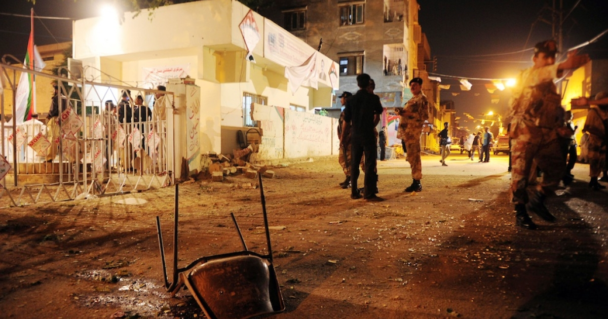 Pakistani security officials stand guard at the site of twin bomb blasts near the secular Muttahida Qaumi Movement (MQM) party office in Karachi on May 4, 2013. Three people were killed and more than 20 others wounded in the blasts near the local party office, police said, ahead of next week's historic elections.</p>