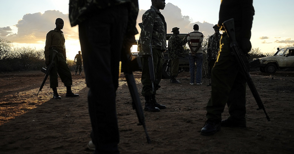 Kenyan security forces conduct a search mission of refugees at Liboi, Kenya's border town with Somalia on October 15, 2011.</p>