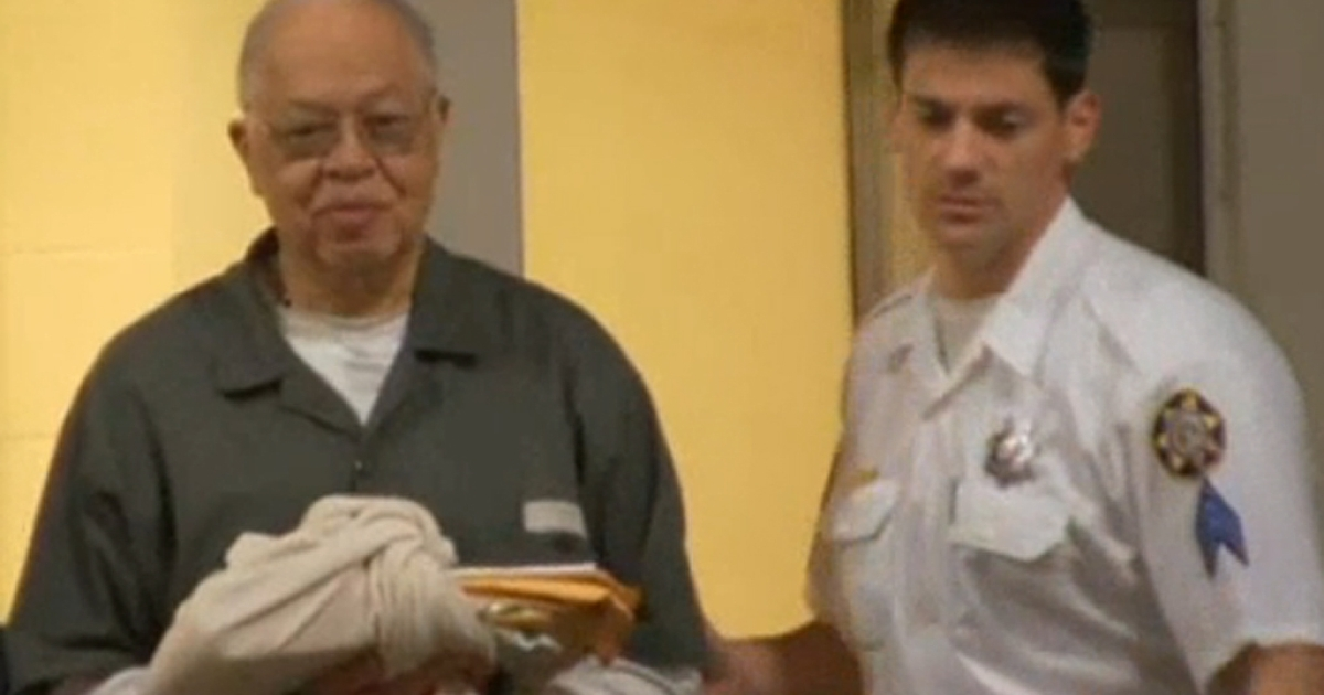 Police lead Dr. Kermit Gosnell into a waiting police car Monday, May 13, 2013, in Philadelphia after a jury found him guilty of murder.</p>