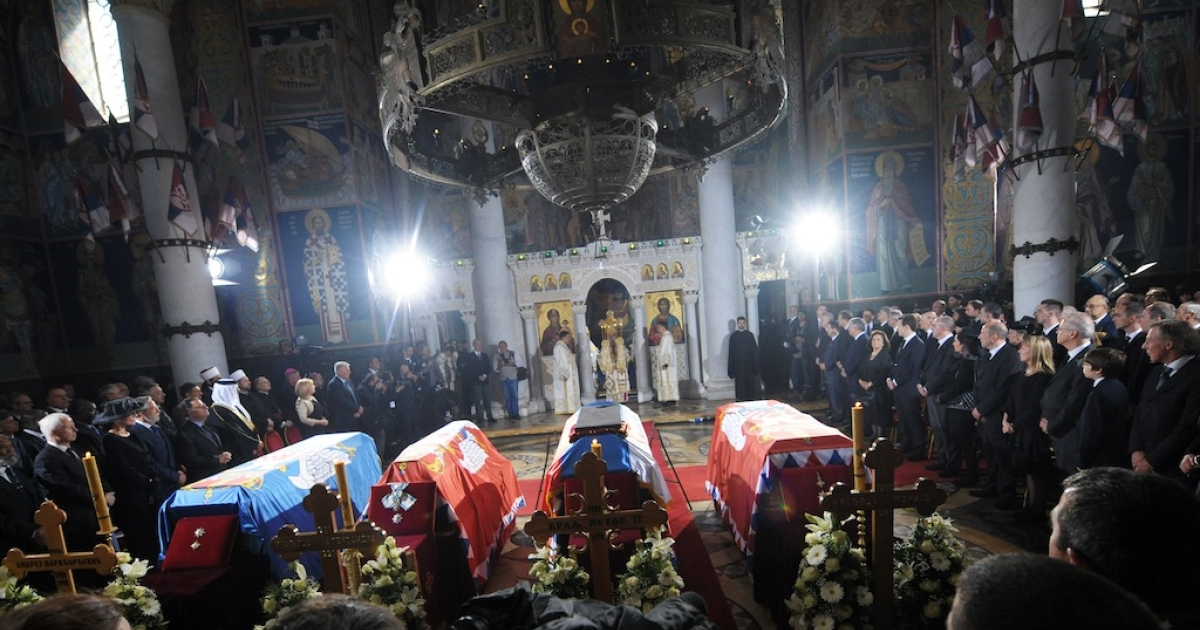 Serbian Patriarch Irinej (C) performs a liturgy during a solemn burial ceremony for the remains of Yugoslavia's last king Petar II Karadjordjevic in the Orthodox church of Saint George in Oplenac on May 26, 2013. The remains of the last Yugoslav king who fled the country in the onset of Nazi invasion, were repatriated today for a re-burial in Serbia, 43 years after his death in exile in the United States. After being exhumed last week from the Serb Orthodox monastery Saint Sava at Libertyville, US, the coffin with remains of Peter II, covered with the Serbian flag, was brought to the church at the Royal palace of Karadjordjevic's in Belgrade.</p>