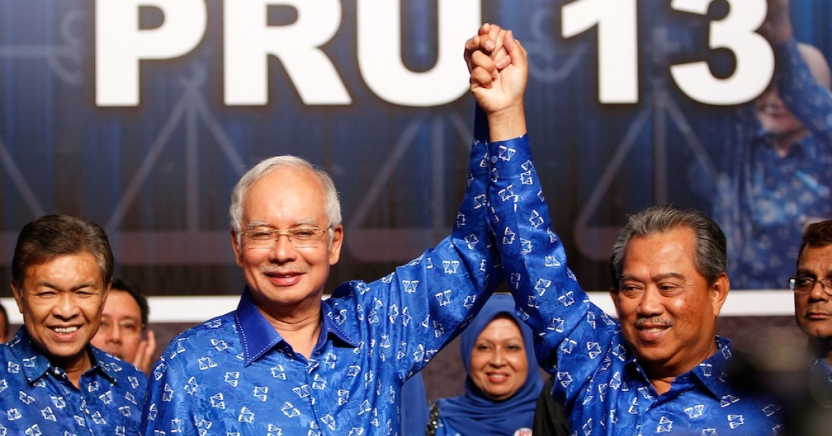 Malaysia's Prime Minister and Barisan Nasional (BN) chairman Najib Razak (2nd L) celebrates his victory with Deputy Prime Minister Muhyiddin Yassin on election day at the PWTC on May 5, 2013 in Kuala Lumpur, Malaysia. Malaysia Prime Minister Najib Razak's coalition won a simple majority in the country's election, defeating Anwar Ibrahim's opposition alliance and extending its 55-year hold on power.</p>