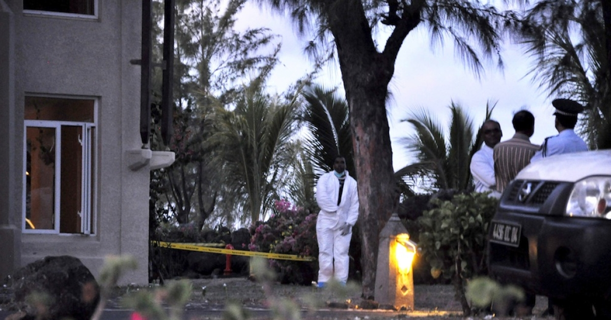 Mauritian police investigators work at the scene of a crime at the Legends Hotel on January 10, 2011 where Michaela McAreavey, the daughter of a top Irish sports personality, was strangled while on honeymoon near Port Louis.</p>