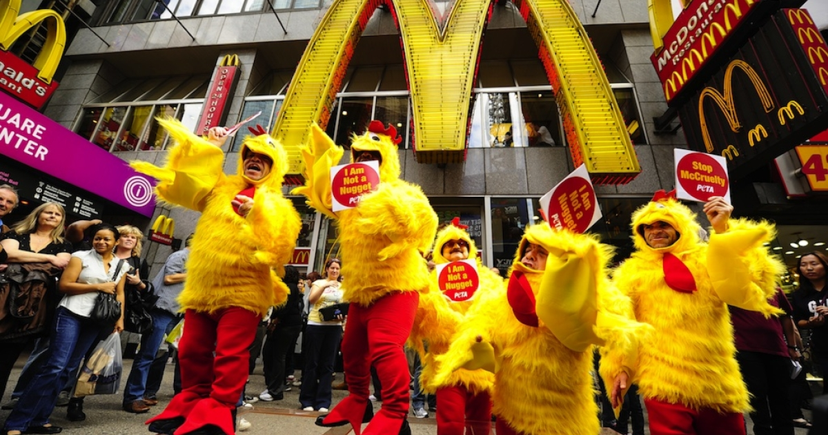 People dressed as chickens stage a dancing protest against animal cruelty on behalf of PETA in front of a McDonald's restaurant at Times Square in New York on October 28, 2010.</p>