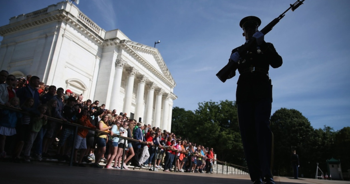 A member of the US Army Old Guard stands guard at the Tomb of the Unknowns at Arlington National Cemetery on May 27, 2013 in Arlington, Virginia.</p>