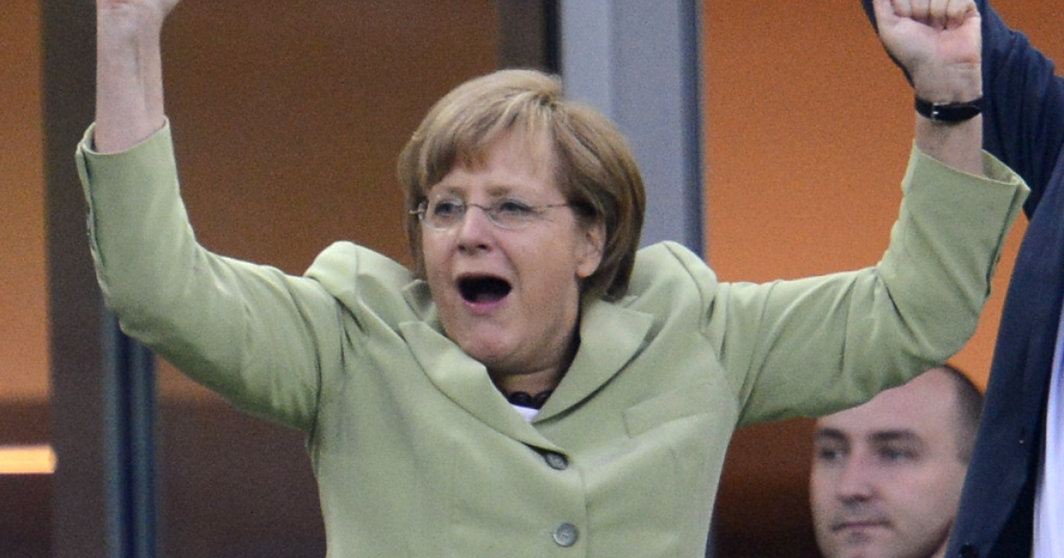 German Chancellor Angela Merkel celebrates after Philip Lahm scored against Greece during the Euro 2012 football championships quarter-final match Germany vs Greece on June 22, 2012 at the Gdansk Arena.</p>