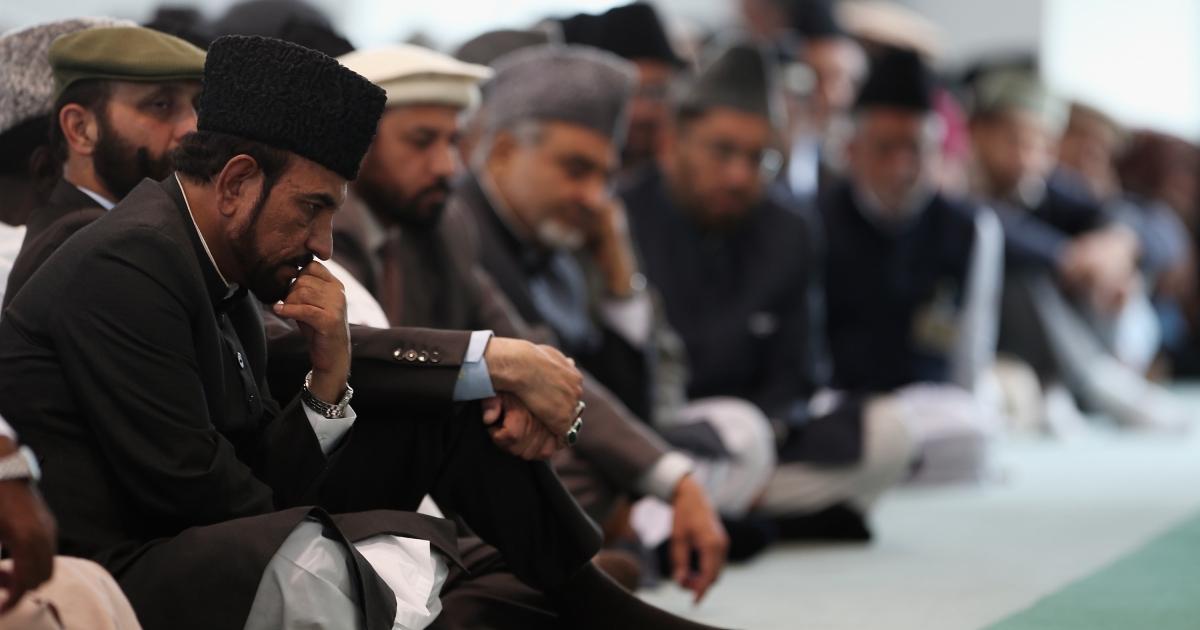 Muslim men listen to a sermon at Baitul Futuh Mosque in London, England.</p>