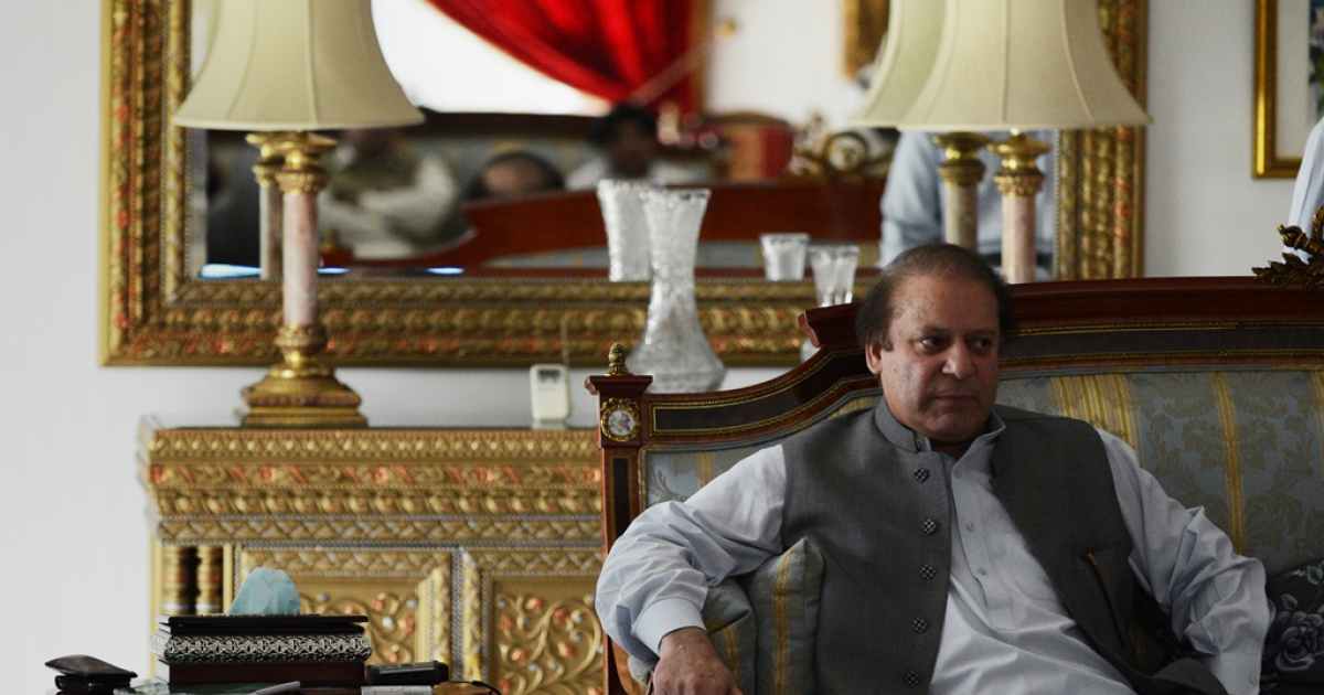 Pakistan's incoming prime minister Nawaz Sharif sits in a sofa in his farm home in Raiwind on the outskirts of Lahore on May 13, 2013.</p>