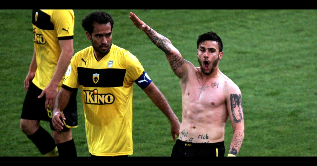 Greek soccer player Giorgos Katidis celebrates a goal with a Nazi salute during a match in Athens.</p>