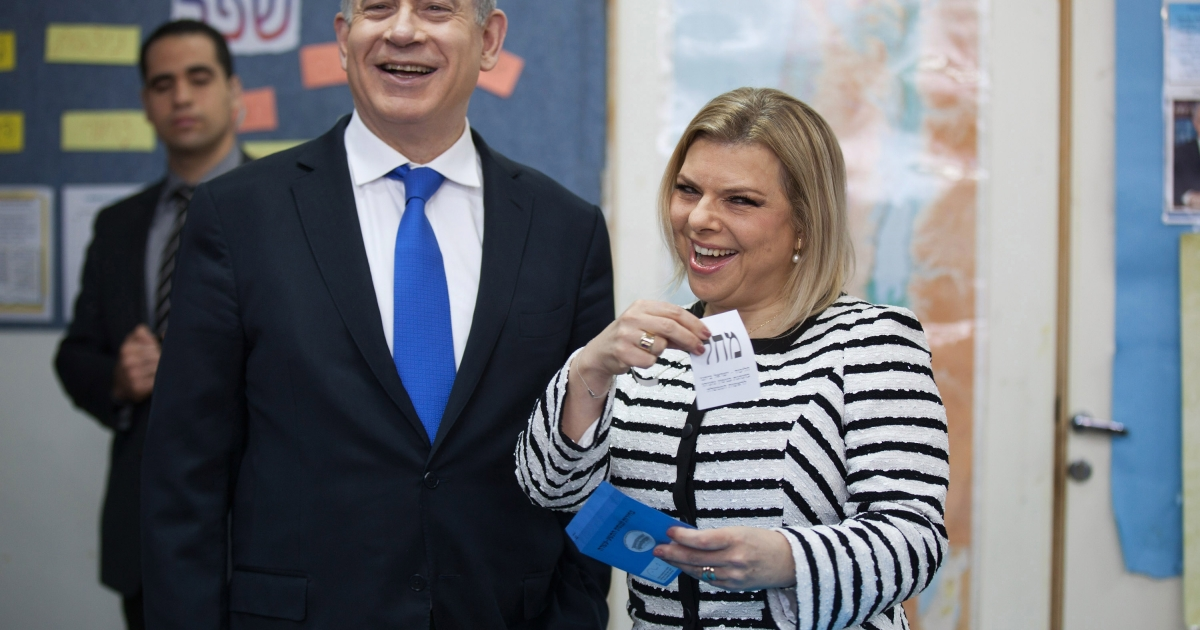 Israeli Prime Minister Benjamin Netanyahu and his wife Sara cast their ballot at a polling station on election day on January 22, 2013 in Jerusalem, Israel.</p>