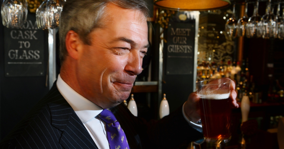 UK Independent Party leader Nigel Farage enjoys a pint of beer in a pub in central London on May 3, 2013. The anti-immigration UKIP was celebrating some of its best ever results following local elections which delivered a bloody nose to Britain's ruling coalition.</p>