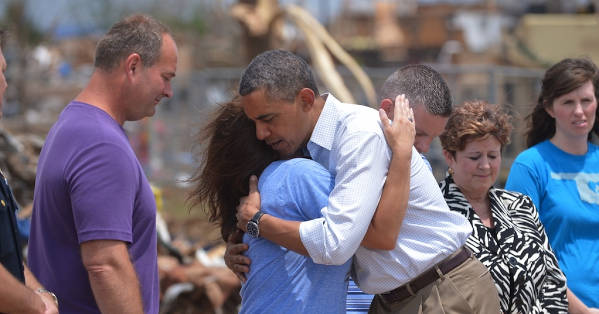 US President Barack Obama is greeted as he tours a tornado affected area on May 26, 2013 in Moore, Oklahoma. Obama is in the Oklahoma City area to survey damage from the tornado which struck a week ago and meet with victims and first responders.</p>
