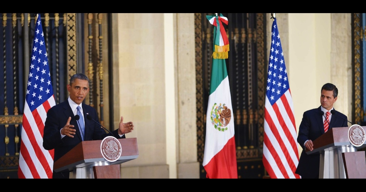 US President Barack Obama (L) speaks during a joint press conference with Mexican President Enrique Pena Nieto at the National Palace in Mexico City on May 2, 2013. Obama landed in Mexico on Thursday at the start of a three-day trip that will also take him to Costa Rica, with trade, US immigration reform and the drug war high on the agenda.</p>