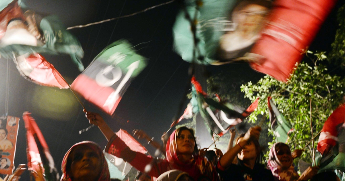Supporters of the Pakistan People's Party (PPP) at an election campaign rally in Lahore on May 6, 2013.</p>