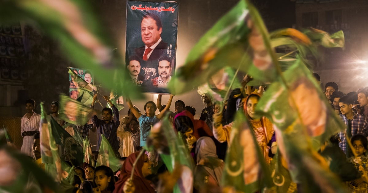 Supporters of Nawaz Sharif, leader of the Pakistan Muslim League-N (PML) party, who took the most votes in the country's election Sunday.</p>