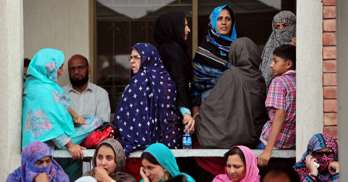 Pakistani election presiding officers and their staff wait for election materials at a distribution point in Rawalpindi on May 10, 2013. The Taliban on Friday stepped up their threats against Pakistan's landmark elections, warning voters to boycott polling stations to save their lives.</p>