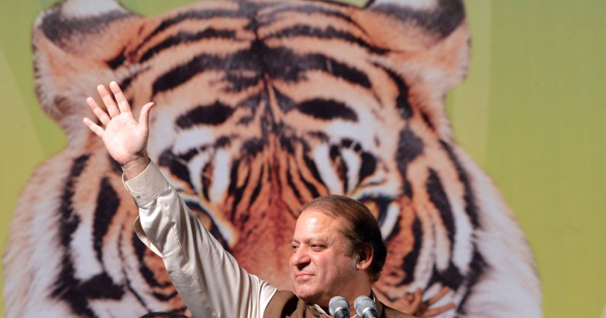 Former Pakistani Prime Minister Nawaz Sharif waves as he addresses his supporters during an election campaign meeting in Islamabad on May 5, 2013. A roadside bomb exploded at an election rally in southwest Pakistan on May 5 killing two people, officials said as violence continued ahead of historic polls on Saturday. Pakistan will elect its new government for the next five years in polls on May 11. The election of the national and four provincial assemblies will mark the first time a civilian government has completed a full term and handed over to another, in a country that has been ruled by the military for half its existence.</p>