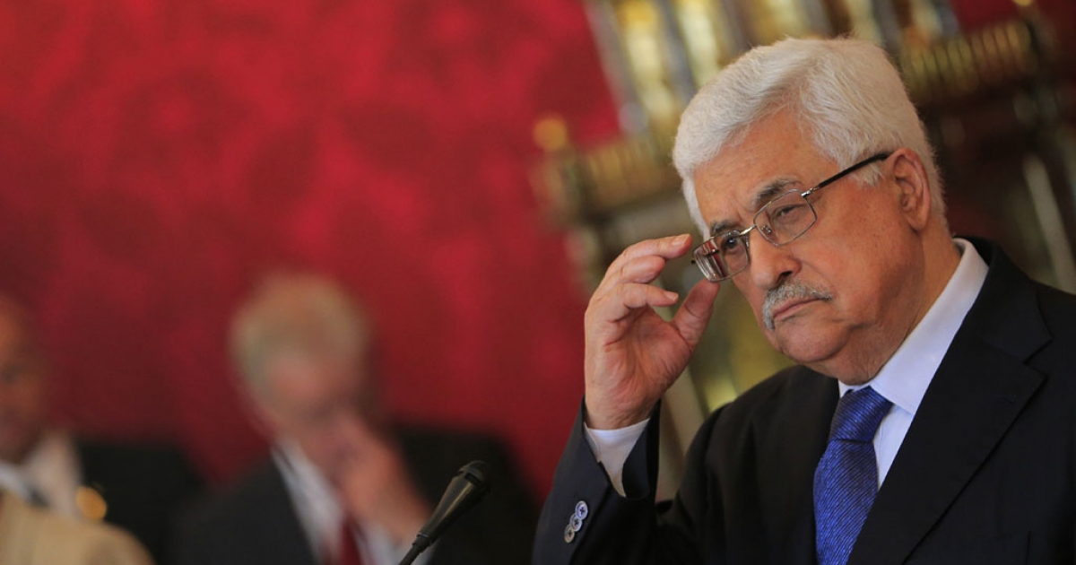 Palestinian President Mahmoud Abbas gestures during a press conference April 30, 2013.</p>
