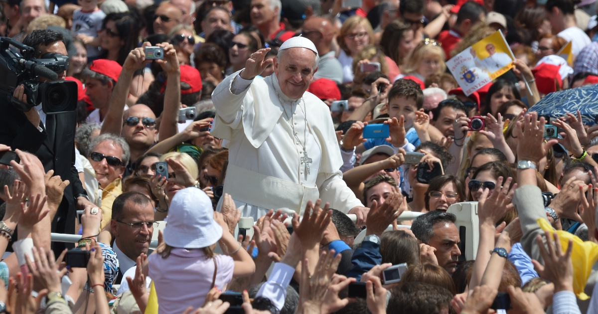 Pope Francis waves to pilgrims on Sunday in St. Peter's Square at the Vatican at the end of a canonizing service, which included new Colombian and Mexican saints.</p>