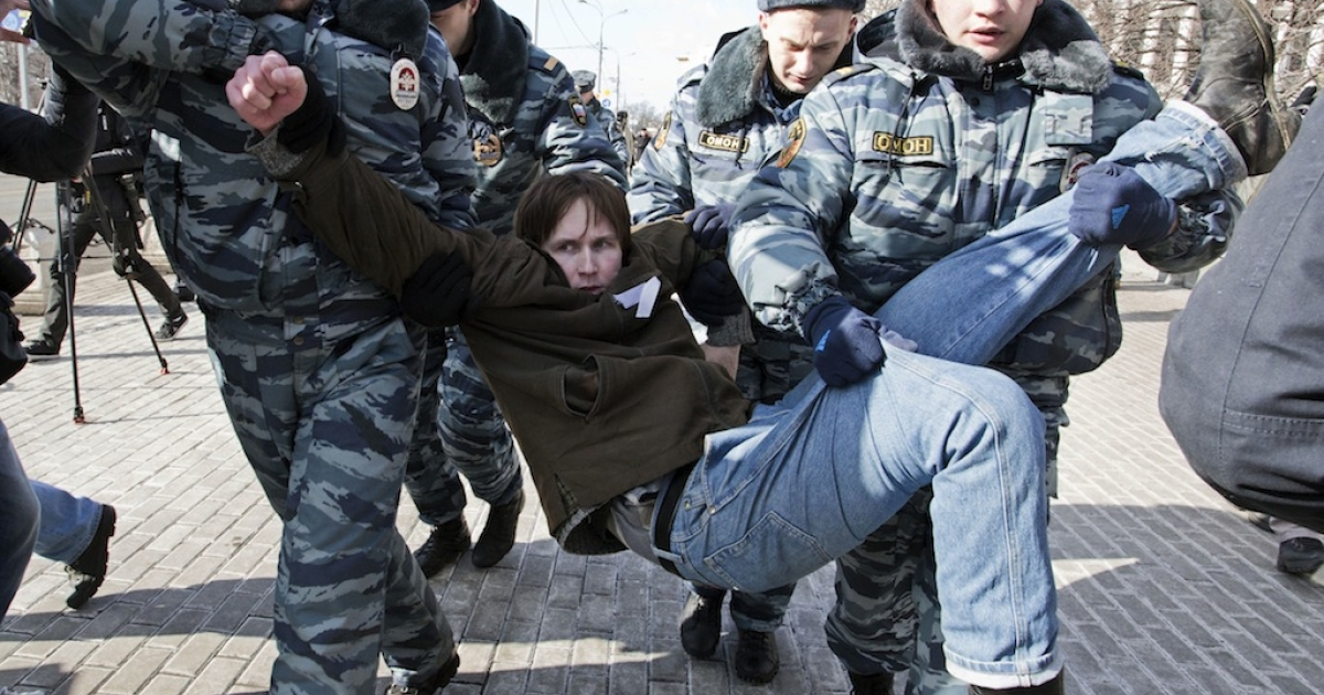 Policemen detain a protester calling for the release of two jailed members of the Pussy Riot protest punk band in central Moscow on March 8, 2013.</p>
