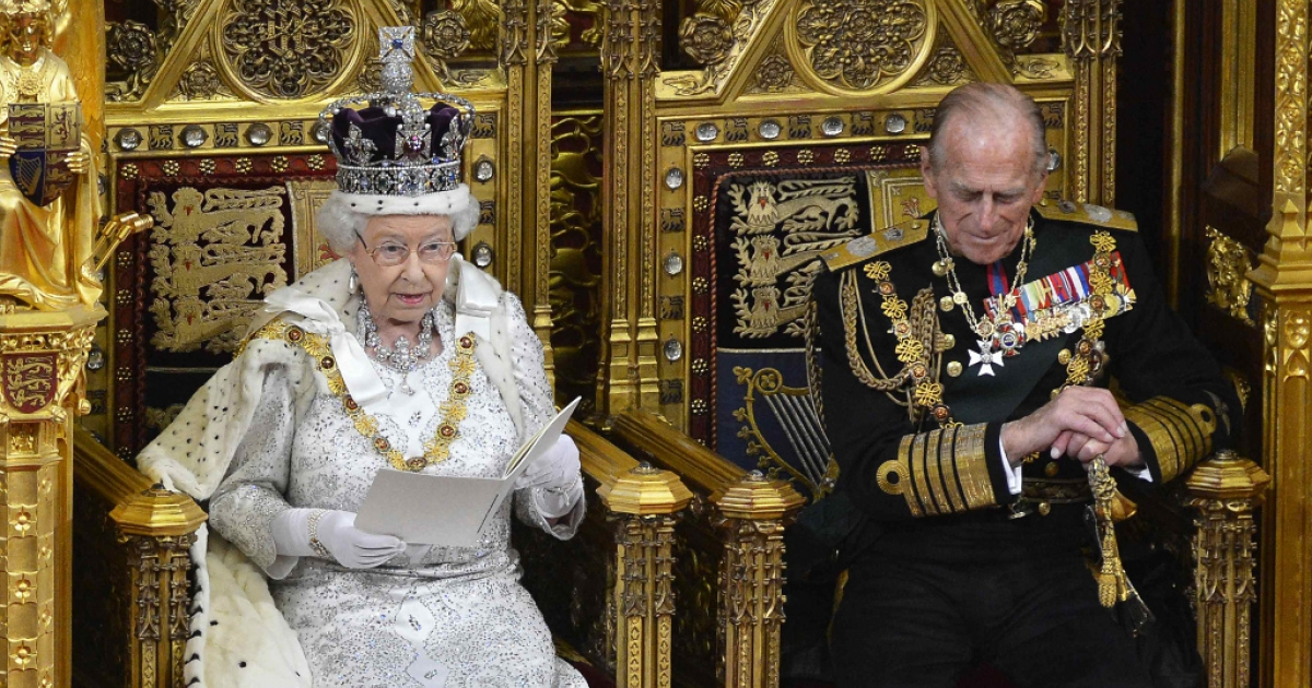 Queen Elizabeth II sits with Prince Philip, The Duke of Edinburgh as she delivers her speech in the House of Lords, during the State Opening of Parliament at the Palace of Westminster in London May 8, 2013.</p>
