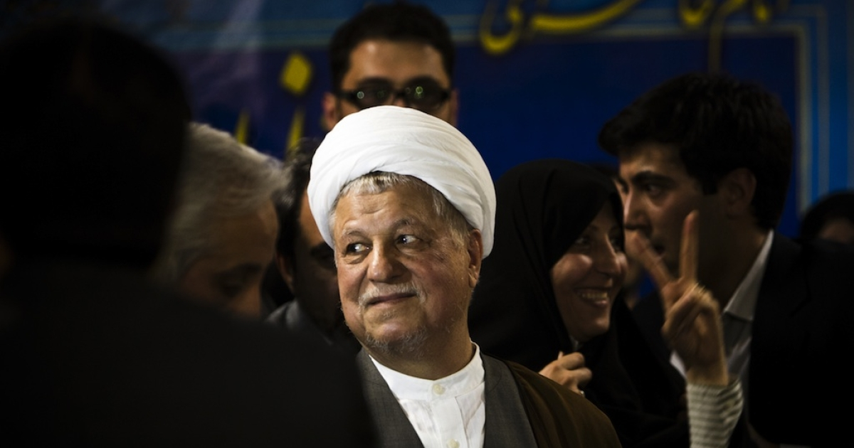 Former Iranian president Akbar Hashemi Rafsanjani (C) arrives to register his candidacy for the upcoming presidential election at the interior ministry in Tehran on May 11, 2013. Rafsanjani, who has been isolated since the 2009 presidential election which saw massive street protests against the disputed re-election of President Mahmoud Ahmadinejad, registered his candidacy to stand for office again.</p>